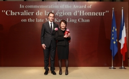 "Mrs Betty Chan Kam Ling (right) received the Distinction of ""Chevalier de la Légion d'Honneur"" for Mr Chan from Mr Marc Fonbaustier, Consul General of France in Hong Kong and Macau (left)"