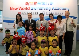 "Gary Chen (second left, back row), Ronnie Wong (third left, back row), guests and the beneficiaries announce the establishment of ""New World Swimming Academy"""