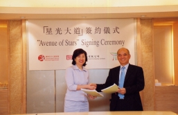 Dr Henry Cheng Kar-shun, Managing Director of New World Development Company Limited and Mrs. Loran Mao, Assistant Director of Hong Kong's Leisure and Cultural Services Department today officially signed an agreement under which New World Group will contribute HK$40 million to finance the design and construction of The Avenue of Stars project aimed at reviving Hong Kong's tourism industry