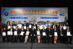 Mr K M So (front row sixth from left), Executive Director of Urban Group, posts with representatives of properties under the Group who have received the 'Best Managed Property' in the Hong Kong Island Best Security Services Awards Presentation